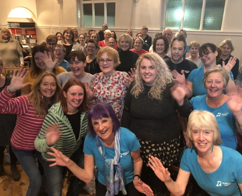 Stella photographed with members of West Bridgford Tuneless Choir